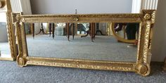 carved wood regency gilt wall mirror