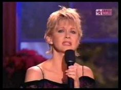 Olivia Newton at kenny loggins christmas show singing silent night