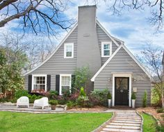 this is what i want for exterior paint colors.  warm gray siding, black shutters & door, white trim.