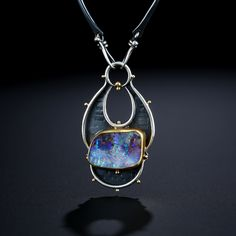 Boulder Opal Centerpiece.  Fabricated Sterling Silver, 22k and 18k Gold. www.amybuettner.com https://www.facebook.com/pages/Metalsmiths-Amy-Buettner-Tucker-Glasow/101876779907812?ref=hl https://www.etsy.com/people/amybuettner http://instagram.com/amybuettnertuckerglasow