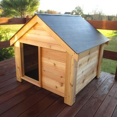 No frills X-large dog house has plenty of room for larger dogs. Constructed with love and care for your dog, the Woodside Dog House is a big dog's dream come true. Large wooden dog house features a a weatherproof roof. Extra Large Dog House, Large Dogs, Cheap Dog Houses, Cãezinhos Bulldog, Luxury Dog House, Wood Dog House, Xl Dog House, Dog House With Porch, Cedar Deck