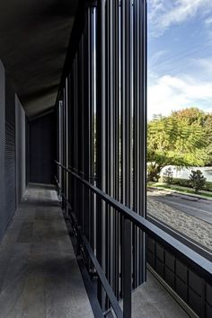 A Modern Residence With Secluded Patio That Establishing Strong Indoor-Outdoor Security : Modern Family Residence Black Metal Shutters Slide