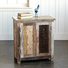 "CARVED WOOD BLOCK CABINET -- Randomly painted carved wood panels rescued from old buildings create unique double doors on this versatile cabinet. Handcrafted entirely of reclaimed wood, each is one of a kind, with varying colors and carving. One fixed shelf. This item will ship from our supplier in 2 to 4 weeks. Additional shipping, $40. 27""W x 16""D x 30""H."