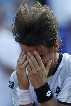 Spain's David Ferrer celebrates defeating Jo-Wilfried Tsonga of France in three sets 6-1, 7-6, 6-2, in their semifinal match at the French Open tennis tournament, at Roland Garros stadium in Paris, Friday June 7, 2013. (AP Photo/Petr David Josek)
