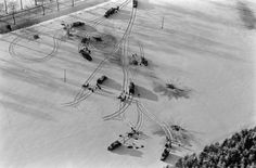 American trucks and half-tracks in a snow-covered Ardennes field, Battle of the Bulge.