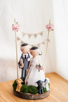 10. OMG, this adorable peg couple with peg pets is almost too cute for words from theroomba's etsy shop! Click here for 20 cake toppers we love!
