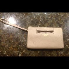 """Kate Spade Leyna Wristlet Kate Spade Leyna Wristlet pebble grain leather finish with a bow on the front and a card slot on the back with a bow shaped out of the stitching.  Zip top closure. Fabric lined interior with 3 card slots.  7"""" x 4.25"""" x 1"""".  NWT.  Comes with a Kate Spade Care Card.  No Trades. kate spade Bags Clutches & Wristlets"""