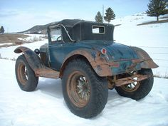 """From Truck Yeah!: People did amazing things to get their mail before we could send messages with a few buttons... like put off-road tires on wooden-spoked wheels. Here's the (mostly) complete and fascinating history of an """"off-road snowmobile coupe"""", as told its by owner/seller who knows of """"at least three"""" in existence."""