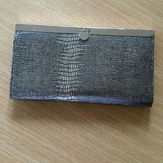 Silver faux snake skin wallet Very delicate material. Silver clasp lock in this tri pocket wallet. Place for DL and debit card, zippered pocket for change or jewelry, and a large credit and rewards cards holder. Bags Wallets