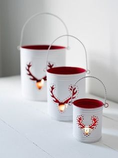 Reindeer Hurricane Lanterns - traditional - holiday decorations - Nordic House