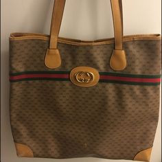 Auth. Vintage Gucci Tote with a golden medallion Authentic Vintage Gucci Tote with a golden medallion. This tote is a timeless piece. GC canvas has light marks as seen in picture. Brown leather straps are firm and light. Brown leather corners on bottom shows some abrasion without worn through. Bicolor ribbon is without marks or wear. Lining is the original with some marks. 15.5 X 13 X 3.35. Gucci Bags Totes