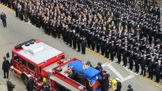Firefighters from across the country take part in the funeral services for Boston firefighter Edward J. Walsh Jr. on Wednesday, April 2, in Watertown, Massachusetts. Walsh was one of two firefighters, along with Michael Kennedy, who died battling a nine-alarm fire in Boston's Back Bay neighborhood on March 26.