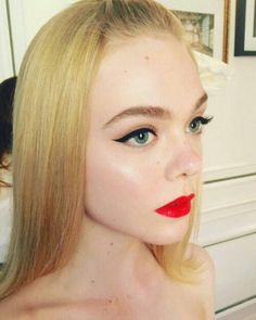 Elle fanning in a classic red lip + winged eyeliner