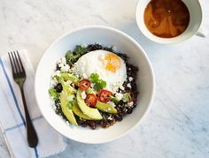 Between the protein in quinoa, beans and eggs, the iron and Vitamin A in spinach, and the good fats (particularly omega 9's) in avocado, this bowl will help keep your hair healthy and your skin glowing and dewy. Plus, it tastes great.