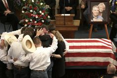 GRIEVING: The family of Kaufman County District Attorney Mike McLelland and his wife, Cynthia, comforted each other during funeral services Friday in Wortham, Texas. The couple was found shot to death Saturday in their house. No arrests have been made. (LM Otero/Associated Press)