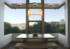 Corner windows maximizing the view of hills and trees. Killer spot for dining!