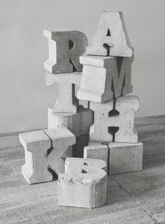 Cast concrete letters by Sigurd Larsen