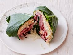 Collard Reuben : <p>Steam lightly salted collard leaves until just shy of tender, then lay them out in an overlapping circle. Wrap around corned beef, sauerkraut and Swiss cheese, and serve with Russian dressing for dipping.</p>  <p></p> via Food Network