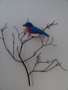 Wool needle felted bird Wall-hanging. Eastern Bluebird on dogwood. Fiber art by Andrea Kingsley. This piece is sold but another one can be made to order.