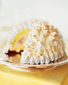 This old-fashioned dessert, which originated at New York City's Delmonico's restaurant to commemorate the United States' purchase of Alaska in 1867, has become popular again, and why not? An ice-cream cake covered with an igloo of meringue emerging from an oven is a real showstopper.