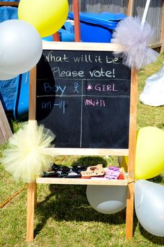 Voting at a Yellow and gray gender reveal baby shower #babyshower #genderreveal