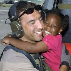 NEW ORLEANS -- A young Hurricane Katrina survivor hugs her rescuer, Staff Sgt. Mike Maroney, after she was relocated to the Louis Armstrong New Orleans International Airport, La., on Sept. Sergeant Maroney is a pararescueman from the Rescue. Images Of Katrina, Katrina Image, Katrina Photo, Teen Bullying, 3 Year Old Girl, 10 Years Later, 5 Years, The Last Laugh, Hurricane Katrina
