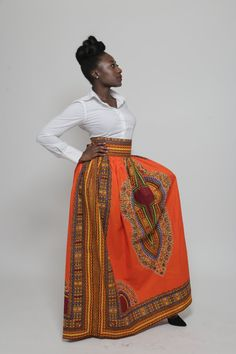 """This dashiki maxi skirt is wide band high waisted. With a beautiful metal zipper fastening at the back,  comes in different colors. We take custom orders which takes just 2 days to complete.    Size: 2  Waist 25"""" - 26""""      Size: 4   Waist 28"""" - 30""""      Size:  6 Waist 31"""" - 32""""      Size: 8 Waist 32"""" - 33""""      Size: 10  Waist 34."""" - 35""""       Size: 12 Waist 36 - 37""""    Size: 14 Waist 38"""" - 40"""" 