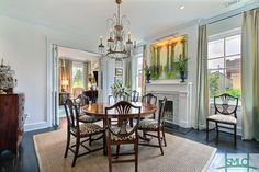 Exceptionally renovated Italianate in Savannah's Landmark Historic District. Matching balconies with beautiful Italian Cyprus trees and hanging baskets are reminiscent of New Orleans and add approximately 200 sf of outdoor living space. Beautiful, open kitchen with Carrera marble and custom tile. Custom window treatments throughout are included, as are two refrigerators & three ice makers-perfect for entertaining.