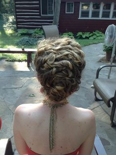 Super Super Easy updo for curly hair.  Just twist and pin, twist and pin, back and forth until you get to the bottom