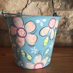 Blur Easter Bucket, Painted Pail, Pale Blue with Flowers, Dakri Sinclair Family Christmas Ornaments, Family Ornament, House Ornaments, Tin Can Crafts, Rock Crafts, Diy Crafts, Painted Flower Pots, Painted Pots, Hand Painted