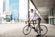 man with bicycle and headphones on city street photo by dolgachov on Envato Elements
