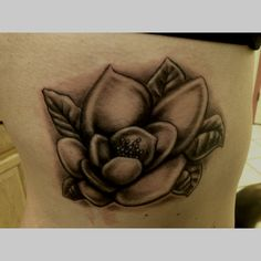 Magnolia tattoo. I want this, but just the outline...possibly in white ink.
