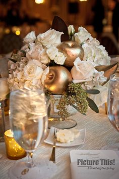 White roses and hydrangeas paired with gold fruits create elegant centerpieces | WM Events