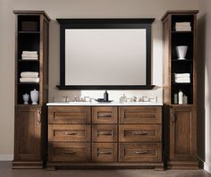 """Crestwood Bath Cabinetry shown with """"St. Augustine"""" door style in Lyptus with Chestnut/Charcoal Glaze finish."""
