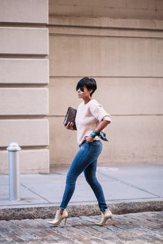 So I have short hair like this. I like the simple outfit with it's spring-like look. Good shade of blue in these jeans and beautiful blush on top and shoes. Sweater knit looks a little thick but probably still flattering (cause not too thick).
