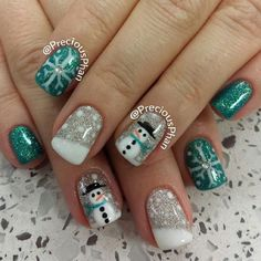 A green and white inspired nail art. Draw in your favorite snowman designs as well as snowflakes and paint on adorable snowman on your nails. Very cute and easy to make.