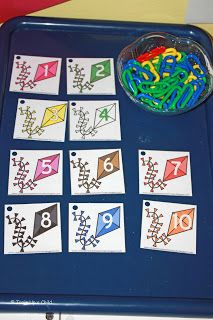 """Kite activities:  Kite math game. Pick a number card and attach that many plastic math links to the hole to make various """"tail"""" lengths."""