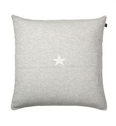 light grey cushion, white star
