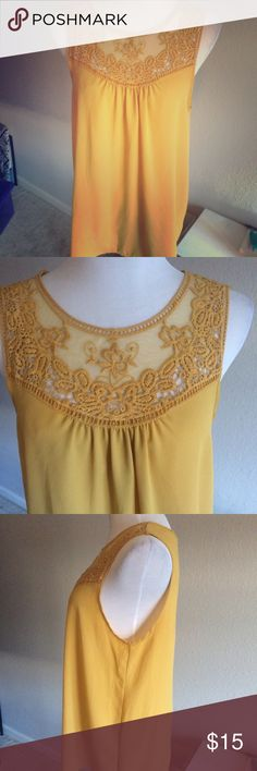 Forever 21 Crochet Lace Mustard Flowy Tank Top Only worn ONCE! In perfect condition. This flowy polyester top is a gorgeous mustard yellow color. Features crochet around the neck for an interesting detail. Super comfy, drapes really nicely. It no longer fits me, or else I would keep it! Make me an offer! Forever 21 Tops Tank Tops
