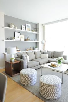 Book shelves at the back are a great idea if i have no room for a library or reading nook. i like the sectional chair lounge as well and the ottomans with a difference coffee table and possibly an armchair.