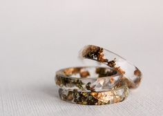 Minimal and elegant, this resin ring is filled with flakes of copper, gold, and green. $50.