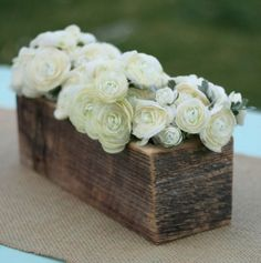 longer box centerpiece with a candle on each side with burlap runner....love