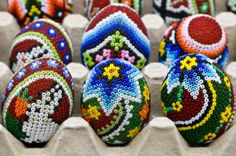 Romanian Easter eggs (oua de pasti) in a carton. Although more of a modern style, some Romanian Easter eggs are decorated using colorful beads.