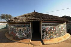 """"""" AN NDEBELE HOUSE PAINTING In the century, the Ndzundza Ndebele people of South Africa created their own tradition and style of house painting. Ndebele houses are painted by women as part of their girlhood initiations. Art Et Architecture, Vernacular Architecture, Amazing Architecture, African House, Afrique Art, Natural Building, House Paint Exterior, African Culture, Traditional House"""