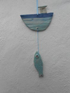 Wind chime with fishing boat and fish