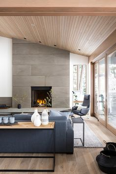 a modern and light colored wooden plank attic ceiling perfectly fits the contemp. a modern and light colored wooden plank attic ceiling perfectly fits the contemporary space Home, House Design, Living Room Designs, New Homes, White Paneling, Wooden Ceilings, Interior Design, House Interior, Modern Fireplace