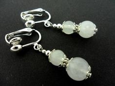 This is a pair of pretty opaque white jade bead dangly clip on earrings.  Measure approx. 4cm (2) long.  With silver plated clips and findings.  These earrings are not for pierced ears.  Thanks for looking