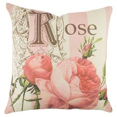 Bring a charming touch to your sofa or favorite reading nook with this cotton denim pillow, featuring a lovely rose motif. Handmade in the USA.