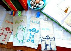 Have the kids do self portraits and turn them into bookmarks.  LOVE THIS!