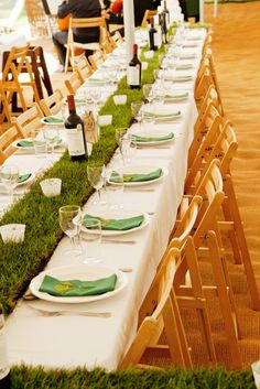 Grass wedding tables http://www.rowanlamb.co.uk/ plus notice the place card detail (names written on leaves).
